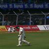An upset Andrew Flintoff walks back