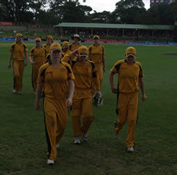 The Australian players coming off the field at the end of the New Zealand innings