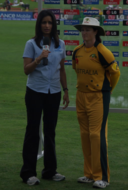 Australian Southern Stars captain Karen Rolton chats to a member of the broadcasting team at the end of the New Zealand innings