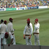 The West Indians stumble onto the field.