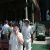 Paul Collingwood and Alistair Cook walk out onto the field
