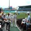 Andrew Flintoff leads England off the field at lunch