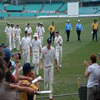 Andrew Flintoff leads England off the field at the close of play