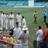 Andrew Strauss and Marcus Trescothick leave the field at the close of play followed by the rest of the England team