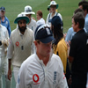 Ian Bell and Monty Panesar leave the field at the close of play