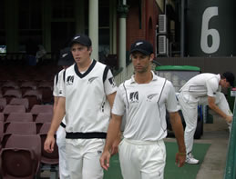 Tim Southee and Grant Elliott with Kyle Mills in the background
