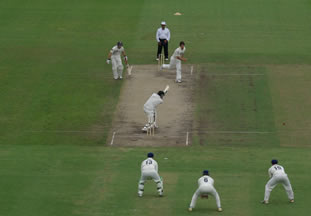 New Zealand batsman hits the ball into the off side