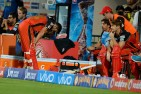 Royal Challengers Bangalore captain and batsman Virat Kohli bends down with disappointment in the players dug out after being bowled out during the final Twenty20 cricket match of the 2016 Indian Premier League (IPL) between Royal Challengers Bangalore and Sunrisers Hyderabad at The M. Chinnaswamy Stadium in Bangalore on May 29, 2016.
