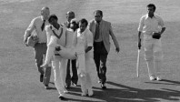 Duleep Mendis carried off after being felled by Thomson