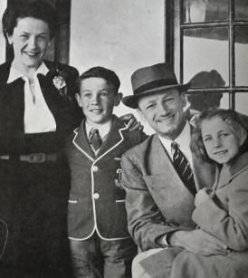 A smiling Don Bradman reunites with his family in 1948